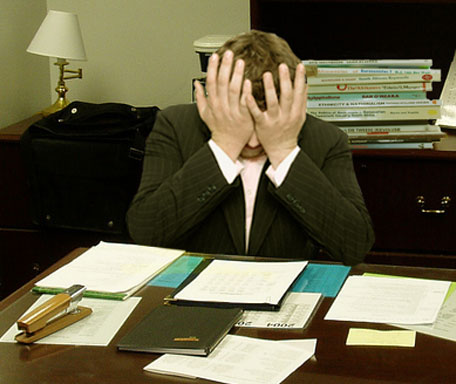 https://commons.wikimedia.org/wiki/File:Frustrated_man_at_a_desk.jpg